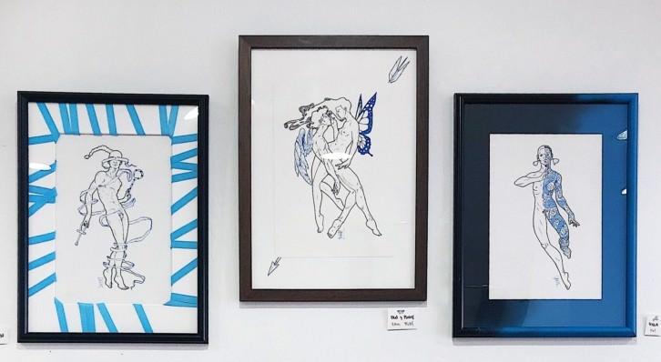 Ilustraciones de TheHugo expuestas en Mamut Concept Store. Fotografía cortesía del artista.